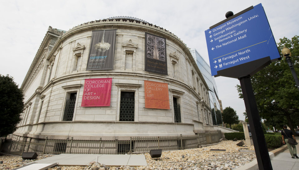 Photo - The Corcoran Gallery of Art in Washington, Monday, Aug. 18, 2014. A District of Columbia judge has decided to approve a proposed merger of one of the nation's oldest museums with two larger institutions in Washington. The ruling Monday from Judge Robert Okun allows the Corcoran to merge the museum and its college into George Washington University and the National Gallery of Art, effectively dissolving the independent art gallery and handing over its $2 billion in assets. (AP Photo/Manuel Balce Ceneta)