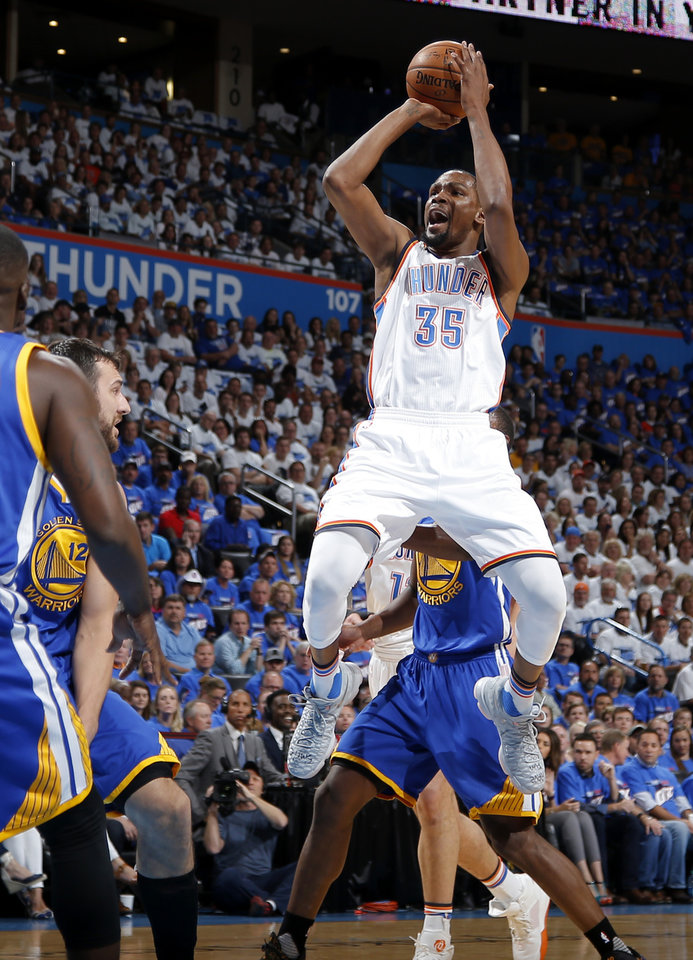 Photo - Oklahoma City's Kevin Durant (35) is fouled as he shoots during Game 3 of the Western Conference finals in the NBA playoffs between the Oklahoma City Thunder and the Golden State Warriors at Chesapeake Energy Arena in Oklahoma City, Sunday, May 22, 2016. Photo by Bryan Terry, The Oklahoman