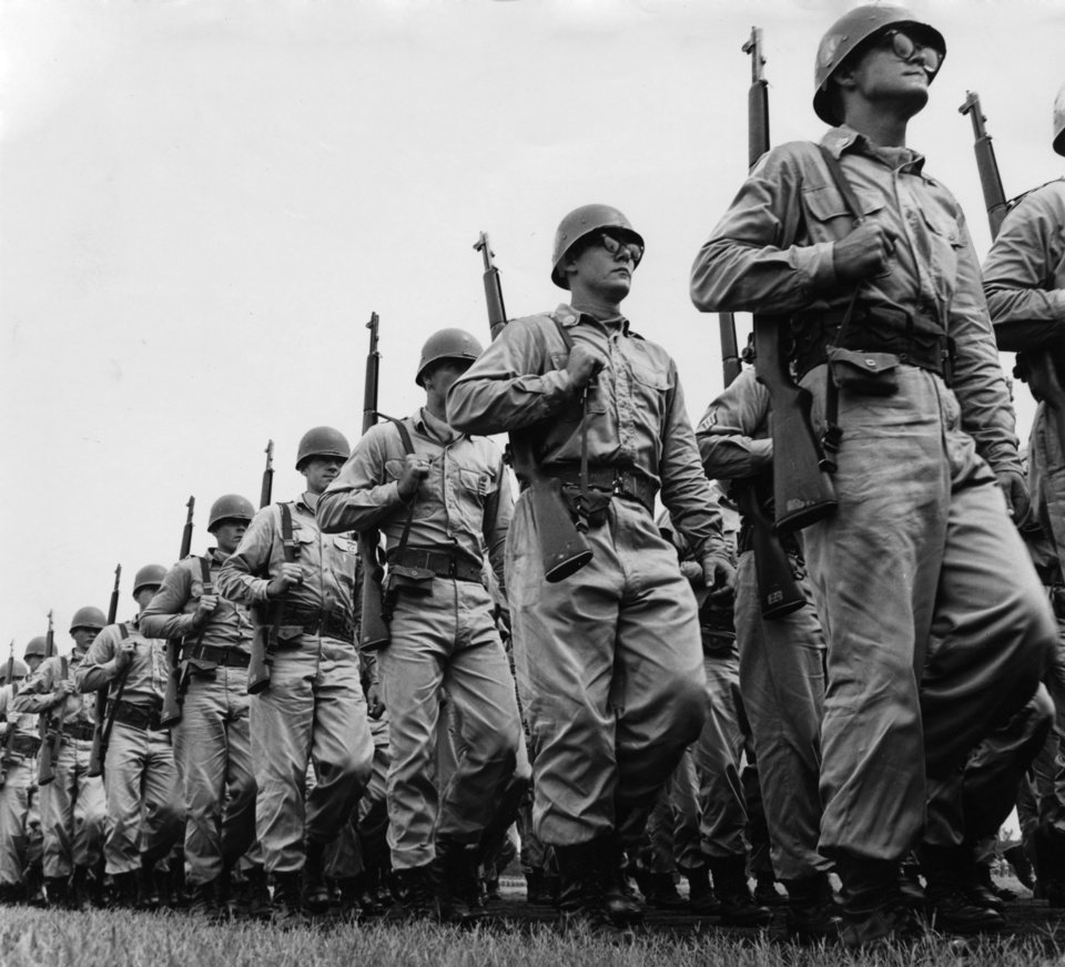 Photo - Fort Chaffee, Ark. - Thunderbirds of Oklahoma's famous 45th Infantry Division flexed their military muscles before 2,100 proud visitors Saturday morning.  The annual Governor's Day parade was threatened for a time by a hard rain that started falling before daybreak but quit an hour before the colorful ceremonies started. Staff photographer unknown.  Photo undated and published on 08/11/1963 in The Daily Oklahoman.