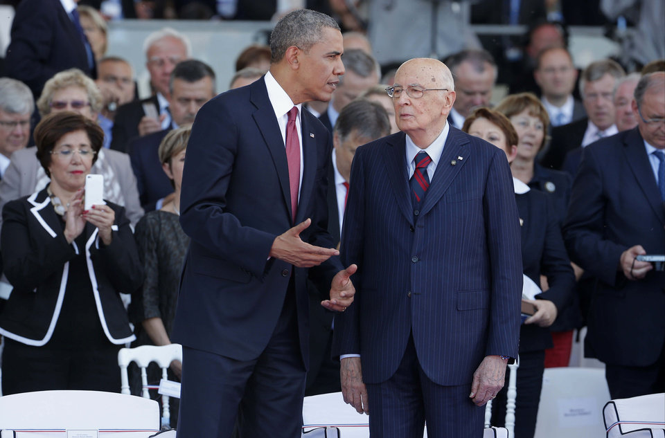 Photo - President Barack Obama talks to Italian President Giorgio Napolitano as they take part in the 70th anniversary of D-Day at Sword Beach in Ouistreham, France, Friday, June 6, 2014. (AP Photo/Charles Dharapak)