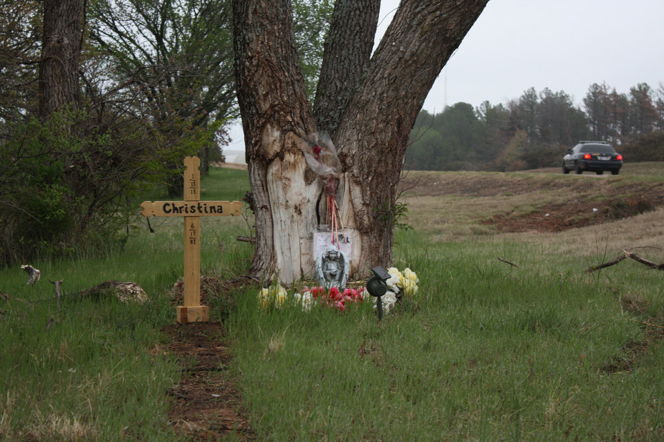 Photo - A roadside memorial for Christina Lynn Hill of Edmond who died on Jan. 13 in a wreck on Highway 51 in Payne County when her car slid off the road and struck a tree  Adam Kemp