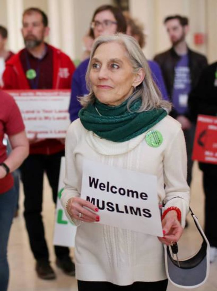 Photo - Joan Korenblit of Edmond, co-founder of the Respect Diversity Foundation, holds a sign of support during the third annual Muslim Day at the Capitol in March 2017. [Photo by Doug Hoke, The Oklahoman]