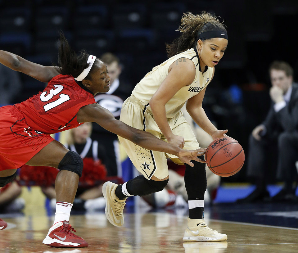 Photo - Georgia guard Erika Ford (31) reaches to steal the ball from Vanderbilt guard Jasmine Lister in the first half of a second-round women's Southeastern Conference tournament NCAA college basketball game Thursday, March 6, 2014, in Duluth, Ga. (AP Photo/John Bazemore)