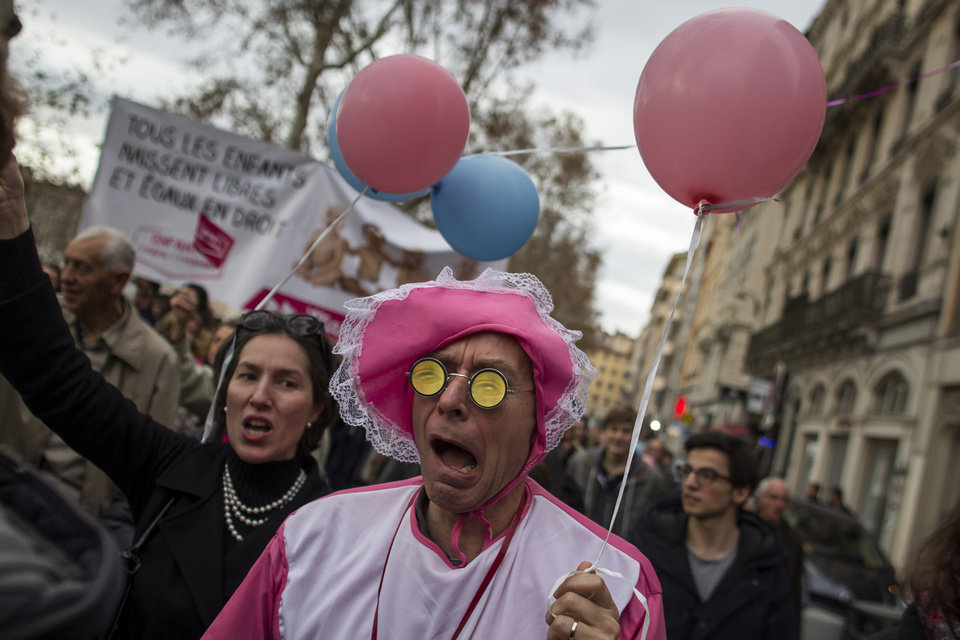 Photo -   Demonstrators protest against French President Francois Hollande's plan to legalize marriage and adoption for gay people, in Lyon, central France, Saturday, Nov. 17, 2012. (AP Photo/Laurent Cipriani)