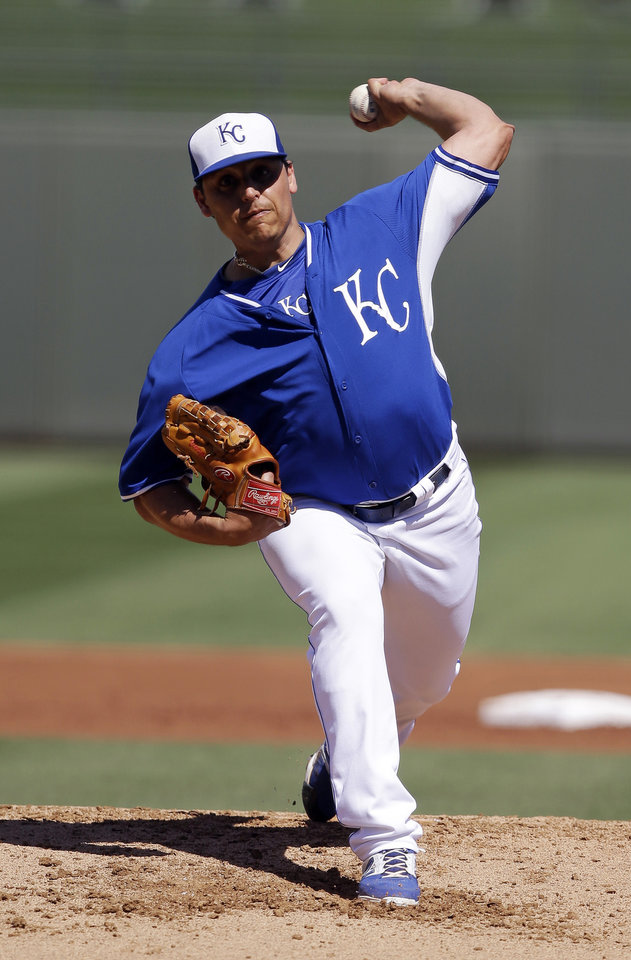 Photo - CORRECTS SPELLING OF SURPRISE - Kansas City Royals starting pitcher Jason Vargas throws during the second inning of a spring exhibition baseball game against the Los Angeles Dodgers, Tuesday, March 11, 2014, in Surprise, Ariz. (AP Photo/Darron Cummings)