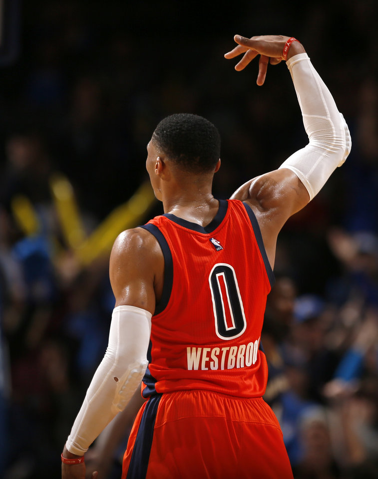Photo - Oklahoma City's Russell Westbrook (0) shoots a 3-point defends late in the fourth quarter during the NBA game between the Oklahoma City Thunder and the New Orleans Pelicans at the Chesapeake Energy Arena,  Sunday, Dec. 4, 2016. Photo by Sarah Phipps, The Oklahoman