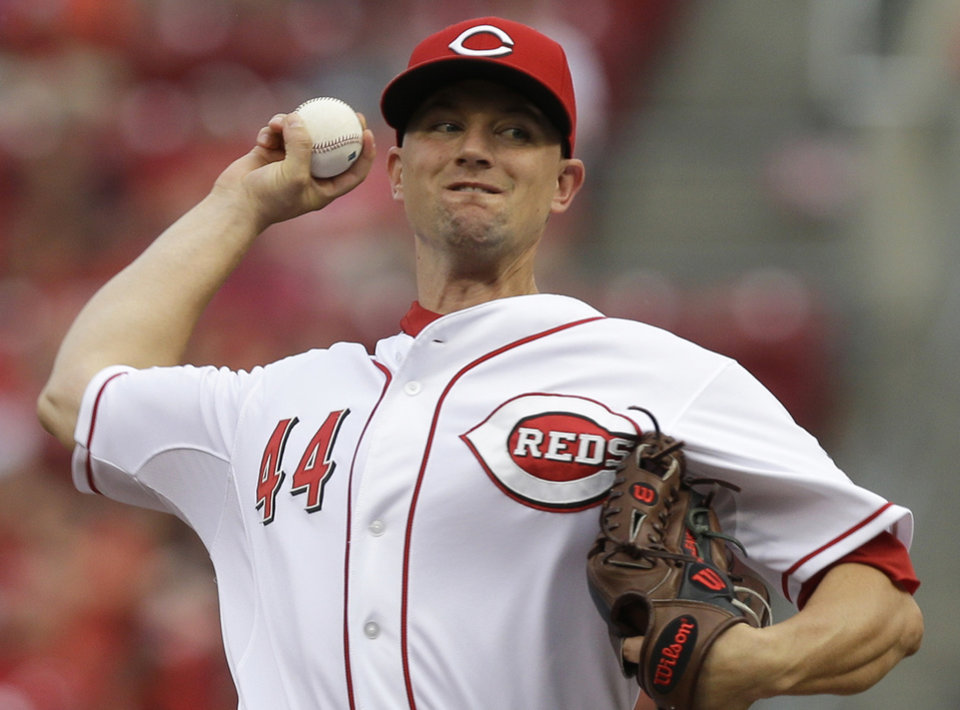 Photo - Cincinnati Reds starting pitcher Mike Leake throws against the Miami Marlins in the first inning of a baseball game, Friday, Aug. 8, 2014, in Cincinnati. (AP Photo/Al Behrman)