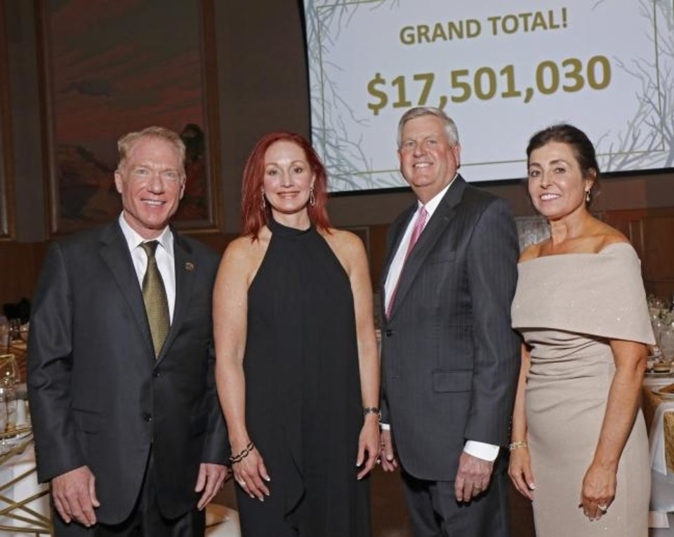 Photo -  Bill and Sherri Lance, Jim Couch and  Debby Hampton pose Friday in front of the 2019 total dollar donation at the 19th annual Snowflake Gala, United Way of Central Oklahoma's celebration of the end of the 2019 fundraising campaign and announcement of the total amount raised, at the National Cowboy & Western Heritage Museum. [Doug Hoke photos/The Oklahoman]