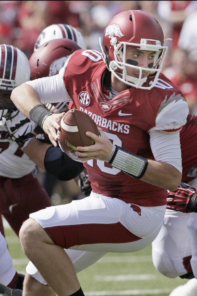 Photo - In this photo taken Oct. 12, 2013, Arkansas quarterback Brandon Allen plays during the second quarter of an NCAA college football game against South Carolina in Fayetteville, Ark. Much of the Razorbacks' hopes fall this season on the expected improvement of quarterback Allen, who battled injuries for much of last season. (AP Photo/Danny Johnston)