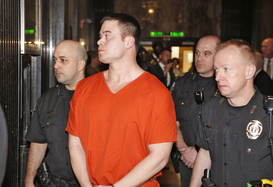Photo - Former Oklahoma City police officer Daniel Ken Holtzclaw, center is led from Judge Timothy Henderson's courtroom at the Oklahoma County Courthouse in Oklahoma City, Thursday January 21, 2016. Holtzclaw was sentenced to 263 years in prison after a jury found him guilty  of 18 sexual offenses. Photo By Steve Gooch, The Oklahoman