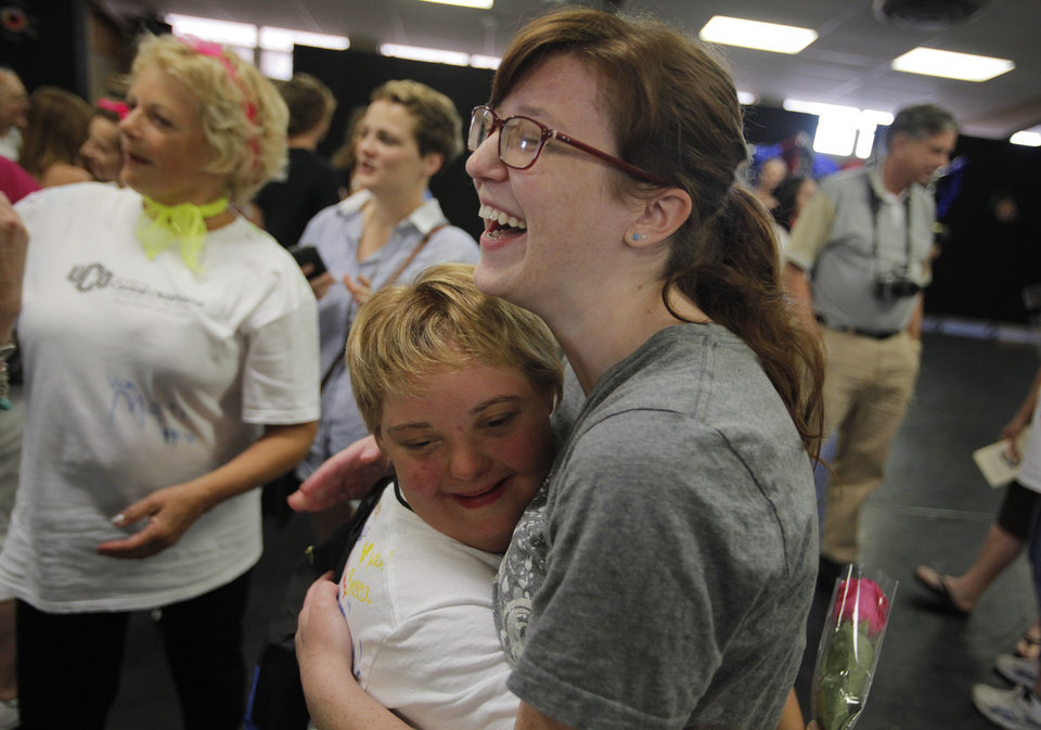 Lauren Lane hugs Shay McCallister after a Dance and Down Syndrome performance of Grease at the University of Central Oklahoma, Friday, June 15, 2012. Photo by Garett Fisbeck, The Oklahoman