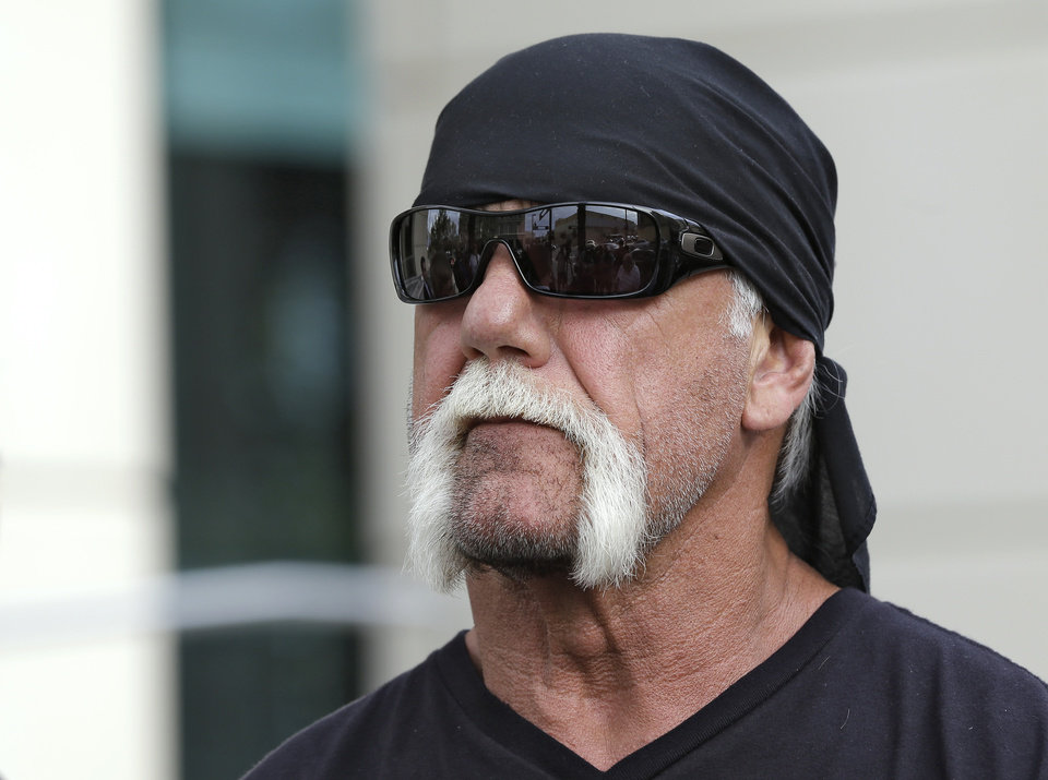 Photo -   Reality TV star and former pro wrestler Hulk Hogan, whose real name is Terry Bollea, looks on as his attorney speaks during a news conference Monday, Oct. 15, 2012 at the United States Courthouse in Tampa, Fla. Hogan says he was secretly taped six years ago having sex with the ex-wife of DJ Bubba