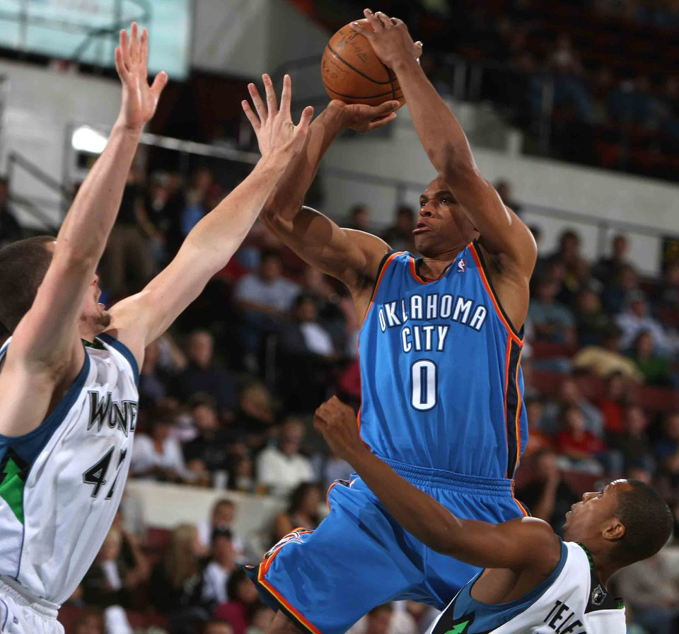 Photo - OKLAHOMA CITY THUNDER NBA BASKETBALL TEAM:  Oklahoma City's Russell Westbrook attempts a shot over Minnesota Timberwolves' Kevin Love, left, and Sebastian Telfair during an NBA preseason basketball game Wednesday, Oct. 8, 2008, in Billings, Mont. (AP Photo/Billings Gazette, Paul Ruhter) ORG XMIT: MTBIL105