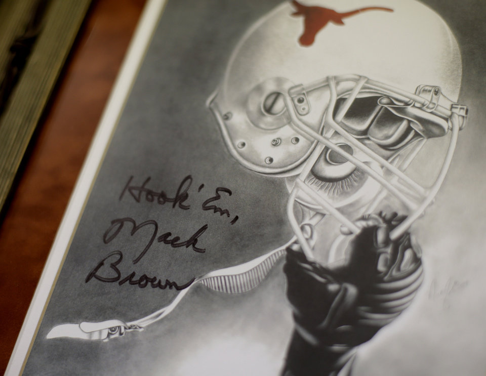 Artwork, part of Former Texas football coach Darrell Royal's Longhorn memorabilia to be auctioned for Alzheimer's research, is displayed at an auction house, Tuesday, Oct. 30, 2012, in Austin, Texas. (AP Photo/Eric Gay)