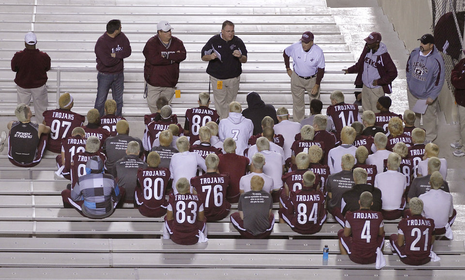 Photo - Members of the Jenks football team have a pre-game meeting during the Class 6A Oklahoma state championship football game between Norman North High School and Jenks High School at Boone Pickens Stadium on Friday, Nov. 30, 2012, in Stillwater, Okla.   Photo by Chris Landsberger, The Oklahoman