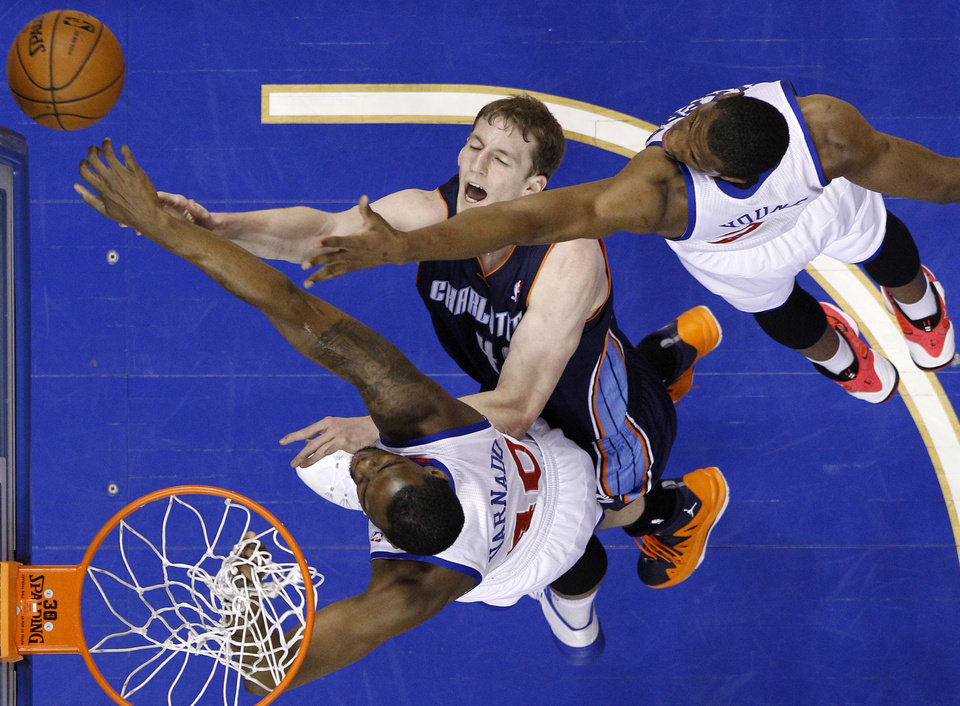 Photo - Charlotte Bobcats' Cody Zeller, center, has his shot blocked by Philadelphia 76ers' Jarvis Varnado, bottom, and Thaddeus Young during the first half of an NBA basketball game, Wednesday, April 2, 2014, in Philadelphia. (AP Photo/Matt Slocum)