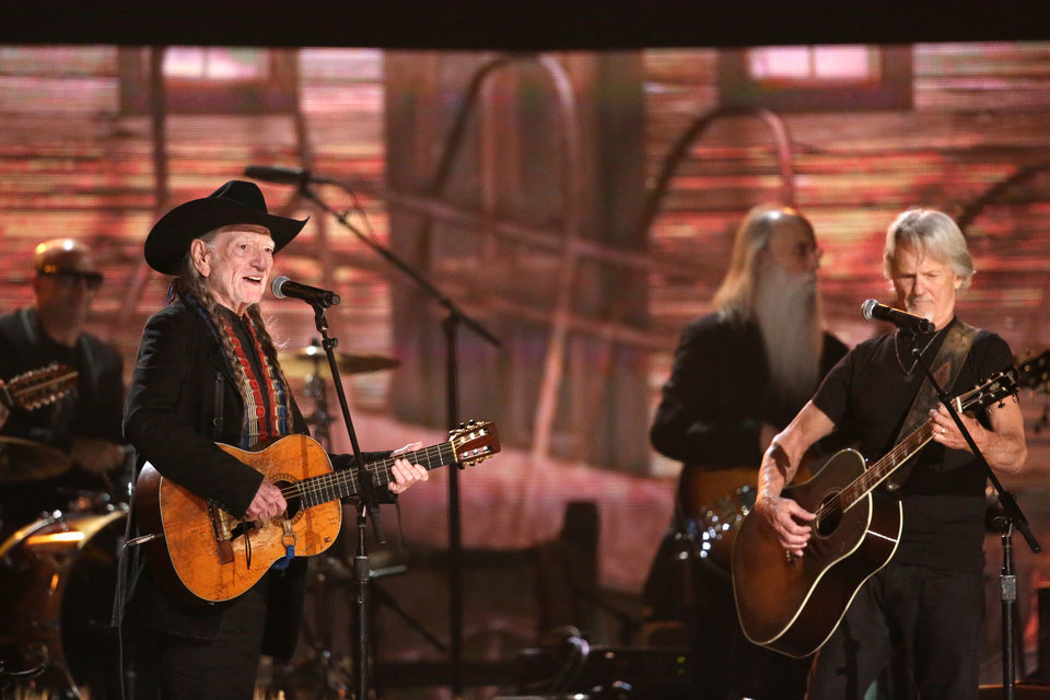 Photo - Willie Nelson, left, and Kris Kristofferson perform on stage at the 56th annual Grammy Awards at Staples Center on Sunday, Jan. 26, 2014, in Los Angeles. (Photo by Matt Sayles/Invision/AP)