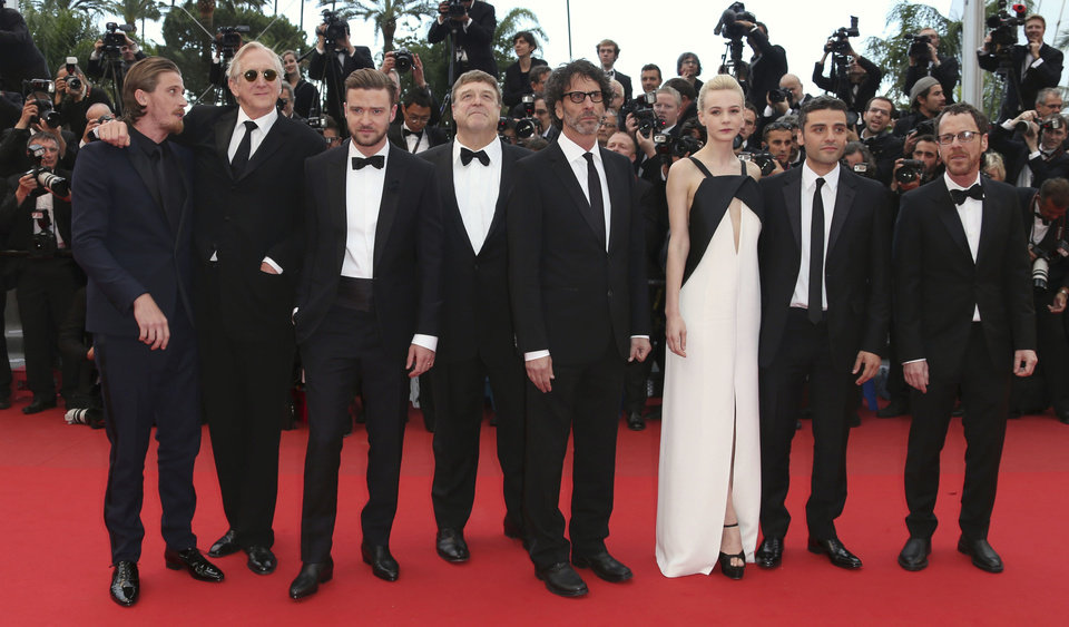 Photo - Cast members, from left, Garrett Hedlund, T-Bone Burnett, Justin Timberlake, John Goodman, Joel Coen, Carey Mulligan, Oscar Isaac, and Ethan Coen pose for photographers as they arrive for the screening of Inside Llewyn Davis at the 66th international film festival, in Cannes, southern France, Sunday, May 19, 2013. (Photo by Joel Ryan/Invision/AP)
