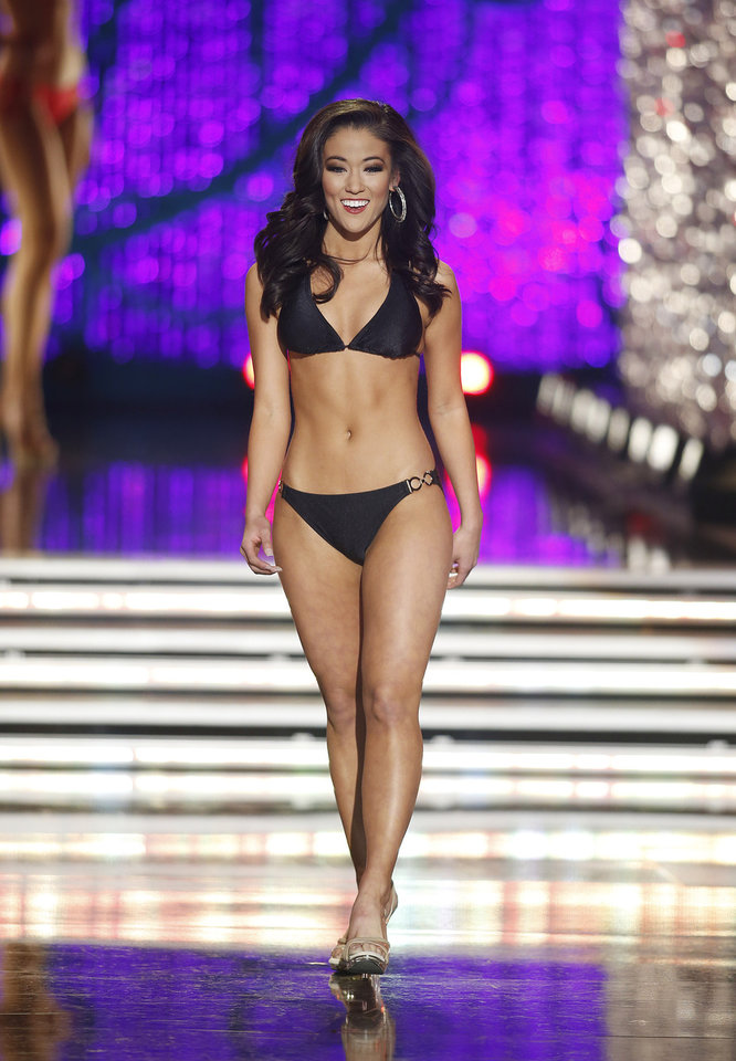 Photo - Miss Oklahoma Alicia Clifton competes in the swimsuit portion of the Miss America 2013 pageant on Saturday, Jan. 12, 2013, in Las Vegas. (AP Photo/Isaac Brekken)