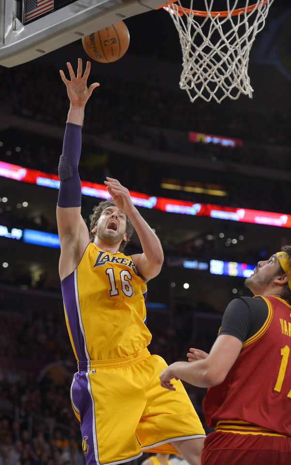 Photo - Los Angeles Lakers center Pau Gasol, left, of Spain, puts up a shot as Cleveland Cavaliers center Anderson Varejao, of Brazil, defends during the first half of an NBA basketball game, Tuesday, Jan. 14, 2014, in Los Angeles. (AP Photo/Mark J. Terrill)