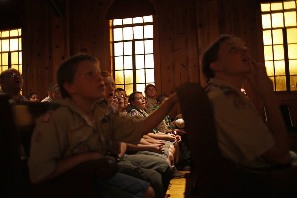Boy Scouts from Troop 20 listen to a paranormal presentation inside the Fort Reno chapel before taking a guided ghost tour by lantern light around the historic fort in El Reno on Saturday, Sept. 21, 2013. The Sneak-N -Peek paranormal research and investigation team helped lead small groups to different historic buildings and the post cemetery while telling paranormal stories for each site. Photo by Bryan Terry, The Oklahoman