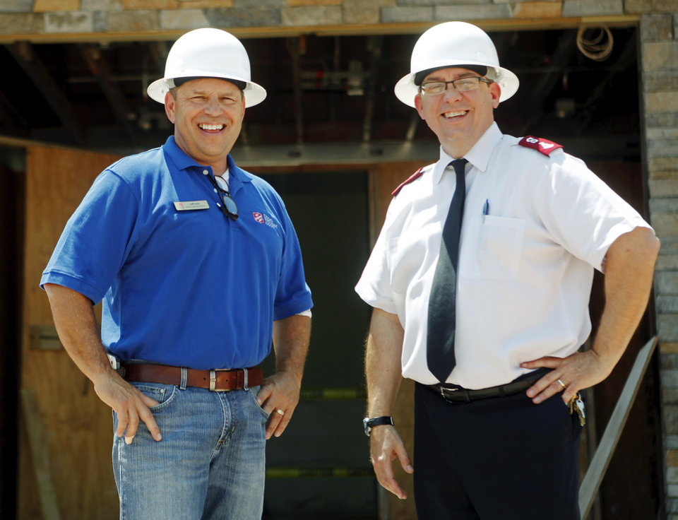 Photo -  Jeff Lara, director of operations for the Salvation Army Central Oklahoma Command and Capt. Carlyle  Gargis, commander of the Salvation Army Central Oklahoma Command, pose for a picture outside of the new Salvation Army Chesapeake Energy Center of Hope at 1001 N Pennsylvania Ave., which is currently under construction. Photo by KT King, The Oklahoman   KT King -