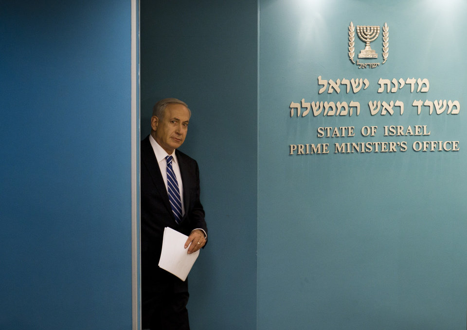 Photo -   Israeli Prime Minister Benjamin Netanyahu arrives at a conference room at the Prime Minister's office in Jerusalem, Tuesday, Oct. 9, 2012. Netanyahu has ordered new parliamentary elections in early 2013, roughly eight months ahead of schedule. (AP Photo/Bernat Armangue)