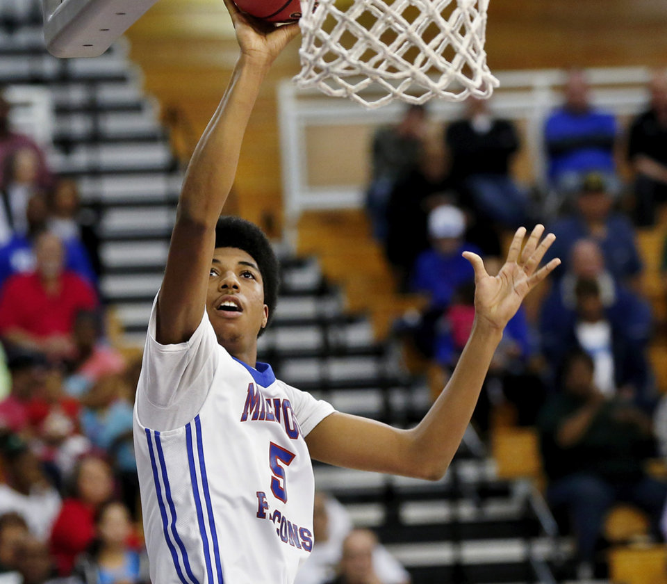 Photo - Lay-up by Millwood senior Ashford Golden in the Class 2A boys basketball quarterfinal game between Millwood and Howe at Oklahoma City University  on Thursday night, Mar. 13, 2014. Photo by Jim Beckel, The Oklahoman