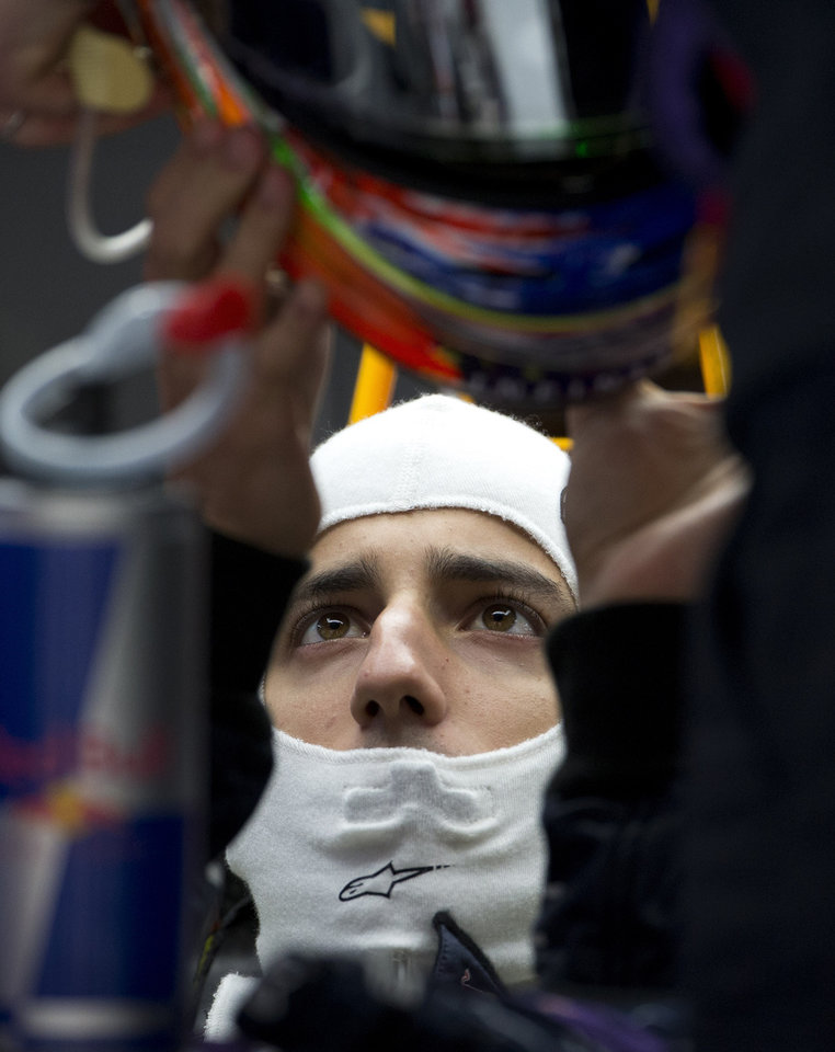 Photo - Red Bull driver Daniel Ricciardo of Australia prepares to wear his helmet during the practice session ahead of Sunday's Chinese Formula One Grand Prix at Shanghai International Circuit in Shanghai, China Friday, April 18, 2014. (AP Photo/Andy Wong)
