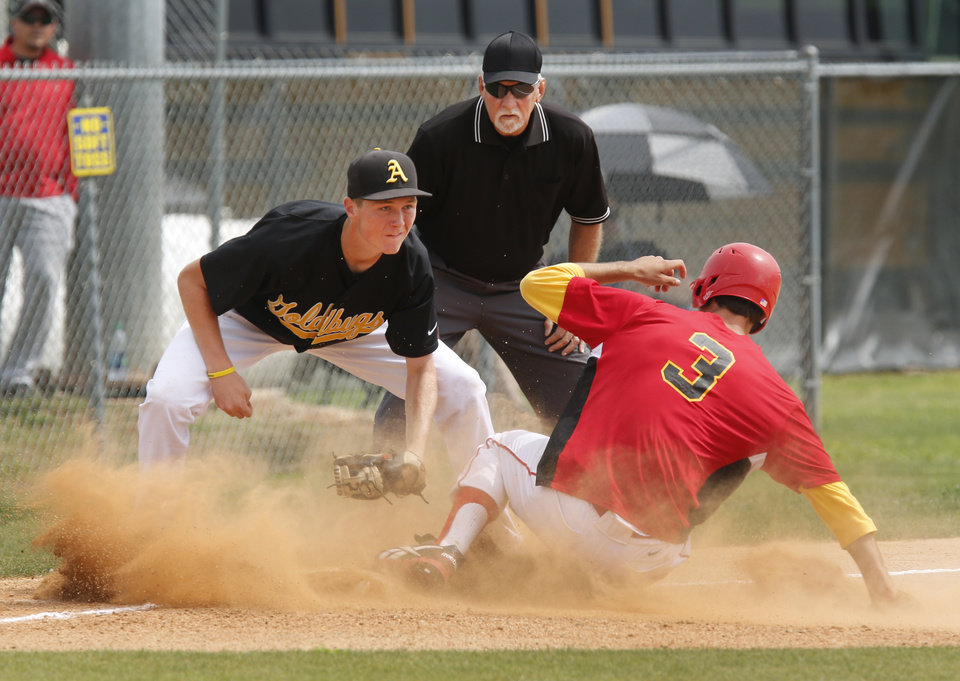 Dale's Evan Anderson slides under the tag of Alva's Lane Madsen at 3rd base during the Class 2A state tournament at Palmer Field in Oklahoma City , Thursday May 9, 2013. Photo By Steve Gooch, The Oklahoman