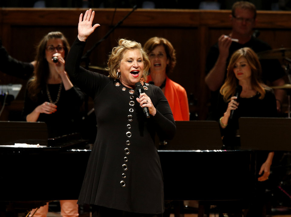 Photo -  Gospel recording artist Sandi Patty performs during the Church of God Convention on Tuesday at Crossings Community Church in Oklahoma City. Photo by Bryan Terry, The Oklahoman   BRYAN TERRY
