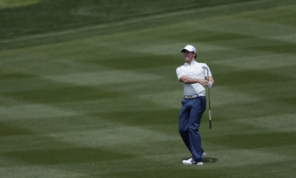 Rory McIlroy, of Northern Ireland, reacts to a chip shot on the second hole during the second round of the Texas Open golf tournament, Friday, April 5, 2013, in San Antonio.  (AP Photo/Eric Gay)