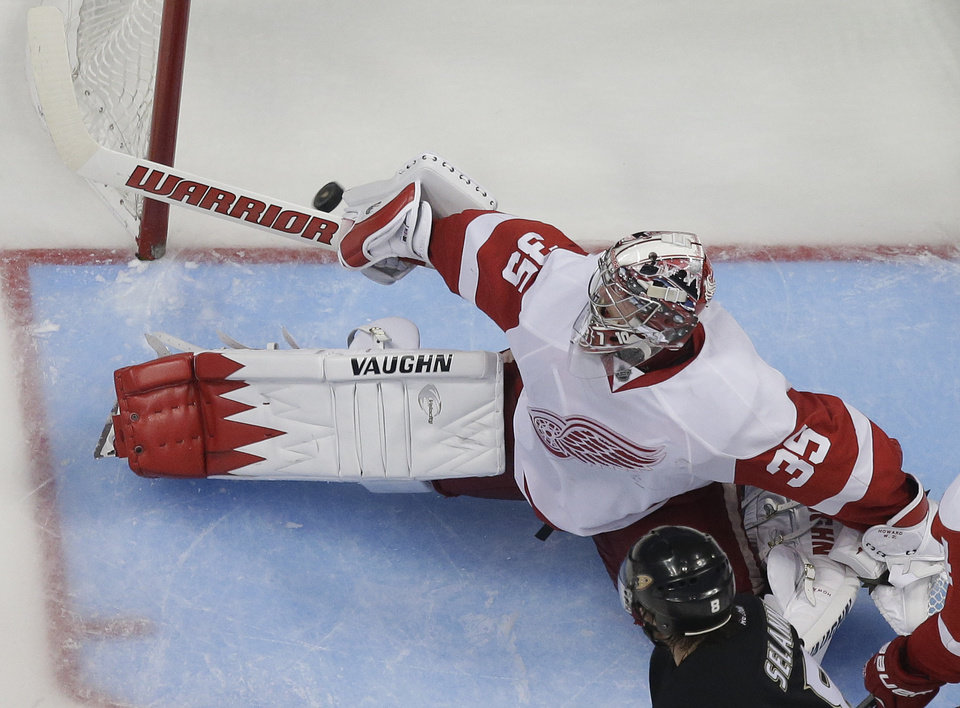 Photo - Detroit Red Wings goalie Jimmy Howard fails to stop Anaheim Ducks' Nick Bonino's game winning goal during overtime in Game 5 of their first-round NHL hockey Stanley Cup playoff series in Anaheim, Calif., Wednesday, May 8, 2013.  The Ducks won 3-2 in overtime. (AP Photo/Chris Carlson)