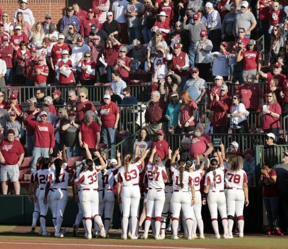 Photo -  The Sooners greet a record crowd at Marita Hynes Field on May 4 in Norman. OU beat rival OSU 3-0 that night to clinch an eighth consecutive Big 12 championship. [Steve Sisney/For The Oklahoman]