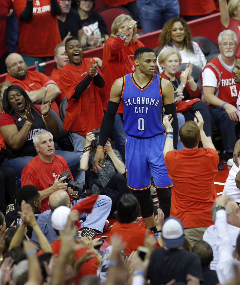 Photo - Fans cheer as Oklahoma City's Russell Westbrook (0) reacts after loosing the ball in the fourth quarter during Game 5 in the first round of the NBA playoffs between the Oklahoma City Thunder and the Houston Rockets in Houston, Texas,  Tuesday, April 25, 2017.  Photo by Sarah Phipps, The Oklahoman