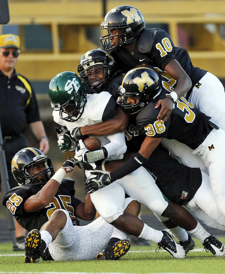 Photo - Edmond Santa Fe's Trevan Smith (2) is gang tackled on a kick return during the high school football game between Midwest City and Edmond Santa Fe at Rose Field in Midwest City, Okla., Thursday, Aug. 30, 2012. Photo by Nate Billings, The Oklahoman