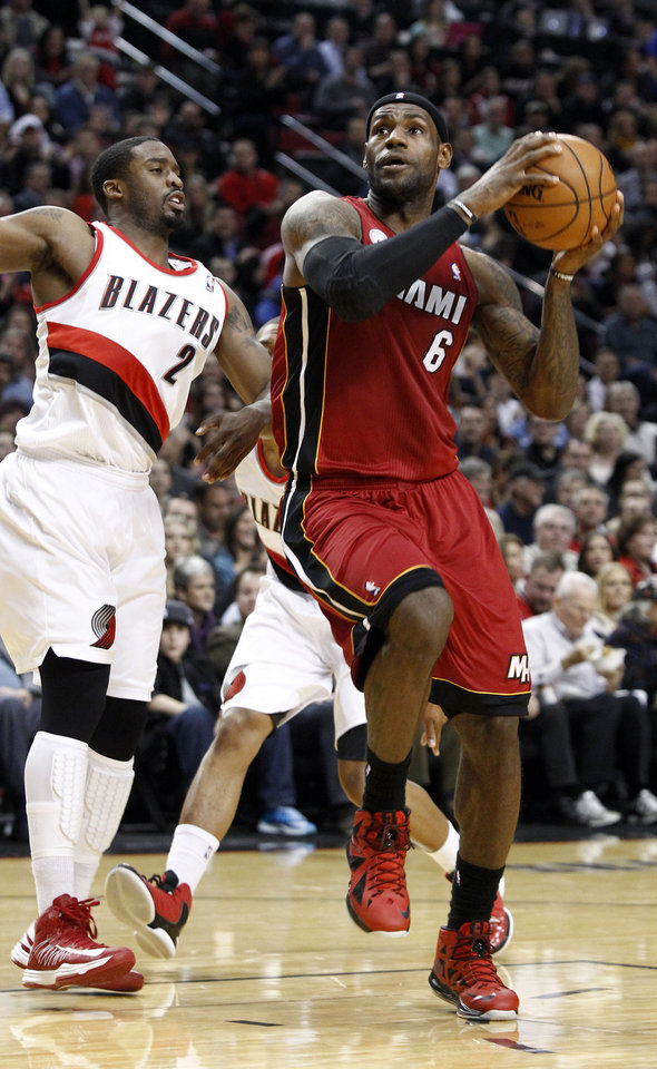 Miami Heat forward LeBron James, right, drives to the basket against Portland Trail Blazers guard Wesley Matthews during the first quarter of an NBA basketball game in Portland, Ore., Thursday, Jan. 10, 2013. (AP Photo/Don Ryan)