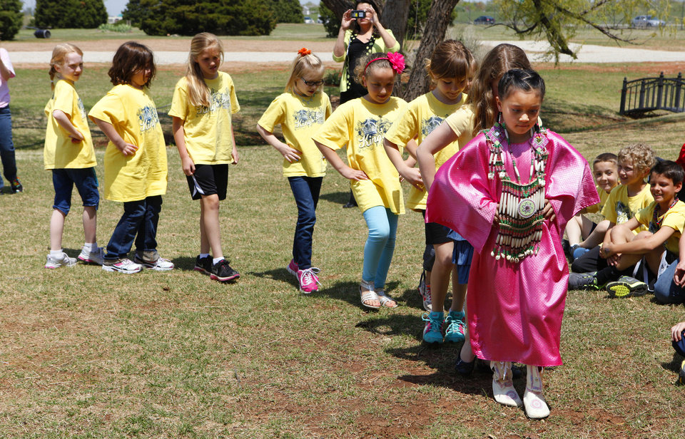 Six-year-old Carley Kihega, of El Reno, leads a cloth dance during a Red Earth Day event for students at King�s Gate Christian School.  Photos by Paul B. Southerland, The Oklahoman