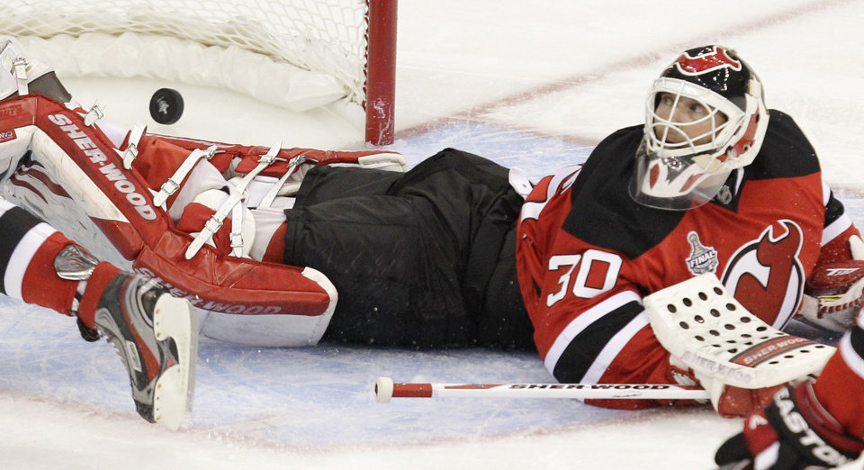 Photo -   New Jersey Devils goalie Martin Brodeur looks over his shoulder after Los Angeles Kings' Anze Kopitar scored the winning goal during overtime in Game 1 of the NHL hockey Stanley Cup finals Wednesday, May 30, 2012, in Newark, N.J. The Kings won 2-1. (AP Photo/Kathy Willens)