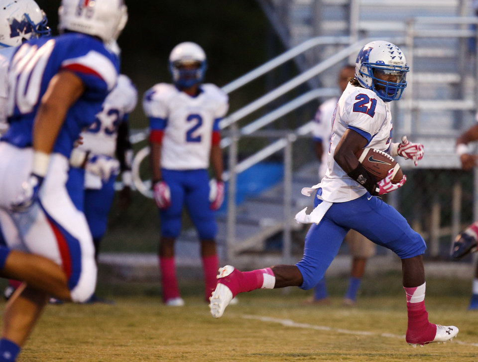 Millwood's Janari Glover outruns the Christian Heritage Academy's  defense on a 94-yard touchdown run during their high school football game at Christian Heritage in Oklahoma City, Friday, Oct. 4, 2013. Photo by Bryan Terry, The Oklahoman