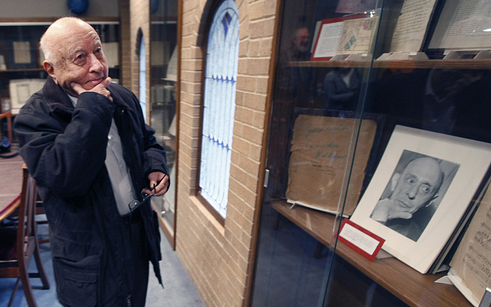 Photo - In this Monday, Dec. 5, 2011 file photo, Arnold Greissle-Schoenberg looks at a display about his grandfather, 20th century composer Arnold Schoenberg, during a tour of the University of North Texas Music Library in Denton, Texas. (AP Photo/LM Otero, File)