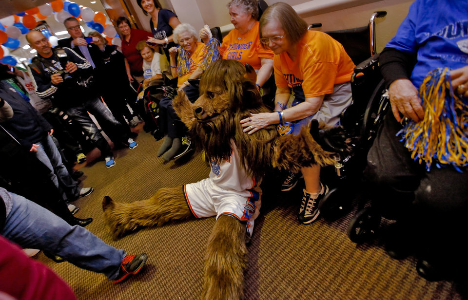 Rumble poses for photos during the Oklahoma City Thunder's 1000th community appearance at Ranchwood Nursing Home on Tuesday, Nov. 27, 2012, in Yukon, Okla.   Photo by Chris Landsberger, The Oklahoman