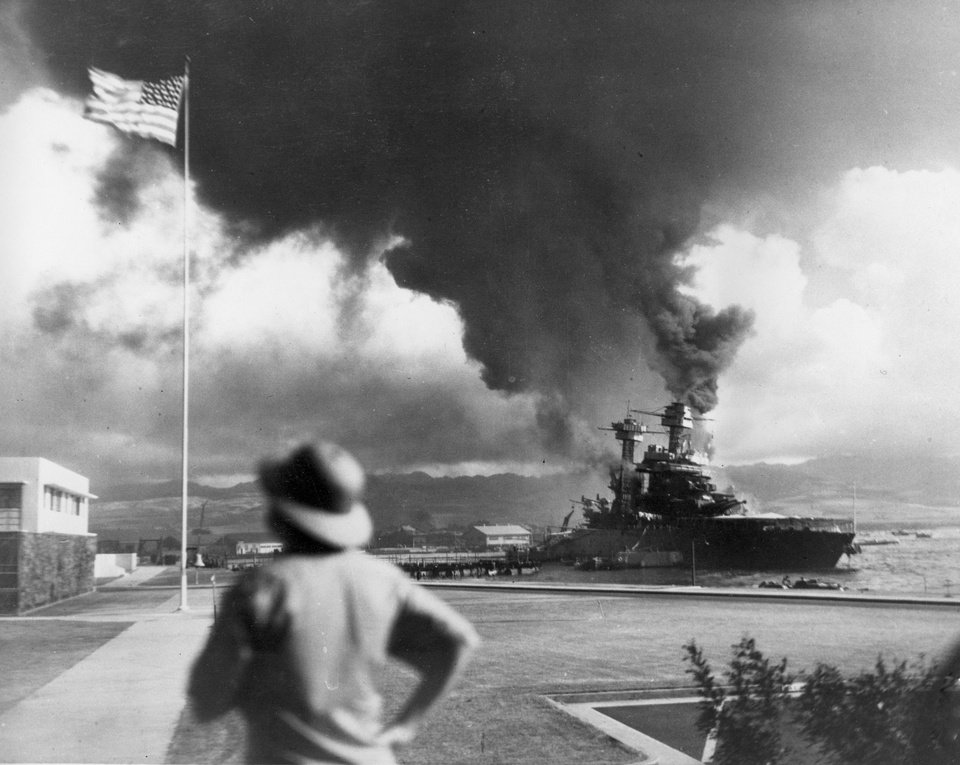 Photo - FILE - In this Dec. 7, 1941 file photo, American ships burn during the Japanese attack on Pearl Harbor, Hawaii. (AP Photo)