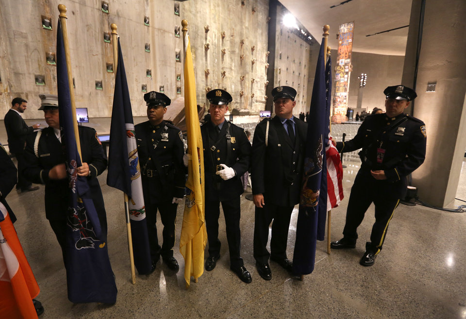 Photo -  The honor guard comprised of members of the New York City police, New York City fire and Port Authority police departments prepare before the dedication ceremony at the National September 11 Memorial & Museum on May 15 in New York. AP Photo   John Munson -