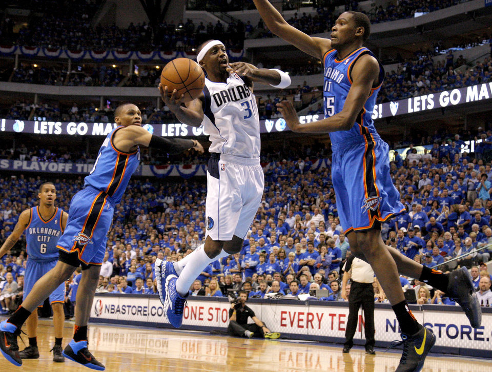 Photo - Jason Terry (31) of Dallas goes between Oklahoma City's Russell Westbrook (0) and Kevin Durant (35) during game 5 of the Western Conference Finals in the NBA basketball playoffs between the Dallas Mavericks and the Oklahoma City Thunder at American Airlines Center in Dallas, Wednesday, May 25, 2011. Photo by Bryan Terry, The Oklahoman