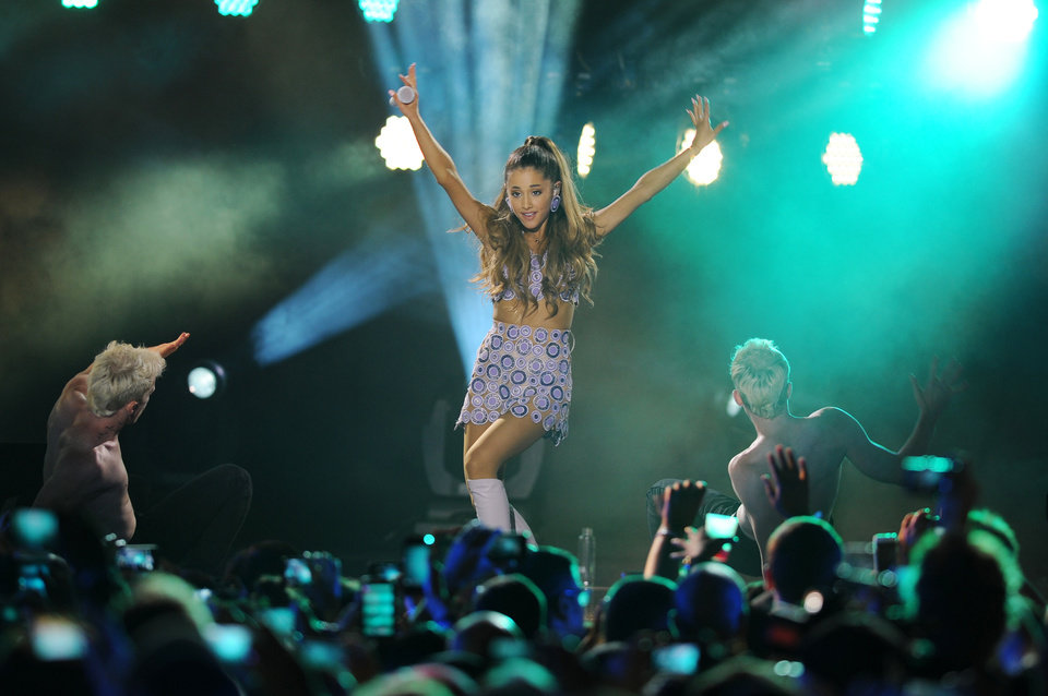"""Photo - FILE - In this June 27, 2014 file photo, Ariana Grande performs at the iHeartRadio Ultimate Pool Party at Fontainebleau's BleauLive at Fontainebleau Miami Beach in Miami Beach. Grande is having a breakthrough in music with the multiplatinum hit """"Problem,"""" which is spending its 13th week in the top 10 on the Billboard Hot 100 chart. The song features rapper Iggy Azalea and is from Grande's sophomore album, """"My Everything,"""" to be released Aug. 25, 2014.  (Photo Jeff Daly/Invision/AP)"""