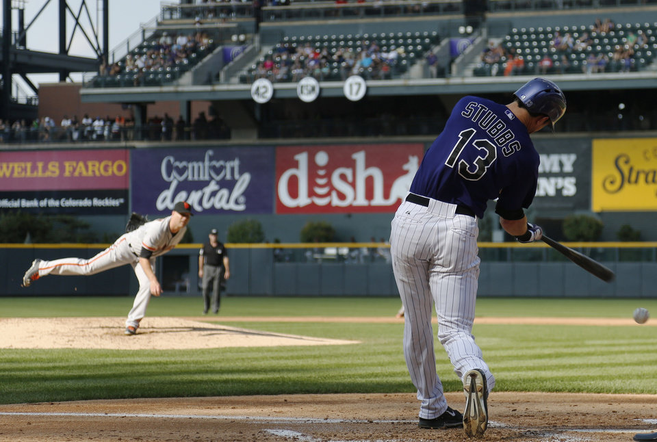 Photo - Colorado Rockies' Drew Stubbs (13) strikes out swinging at pitch delivered by San Francisco Giants starting pitcher Tim Hudson in the first inning of a baseball game in Denver on Monday, Sept. 1, 2014. (AP Photo/David Zalubowski)