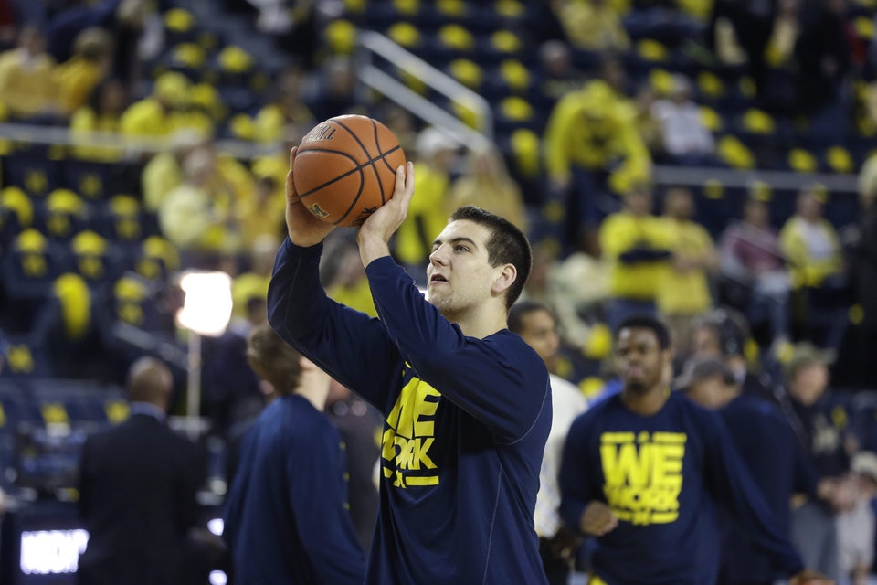 Photo - Michigan forward Mitch McGary (4) practices his free throws before the first half of an NCAA college basketball game against Arizona in Ann Arbor, Mich., Saturday, Dec. 14, 2013. (AP Photo/Carlos Osorio)