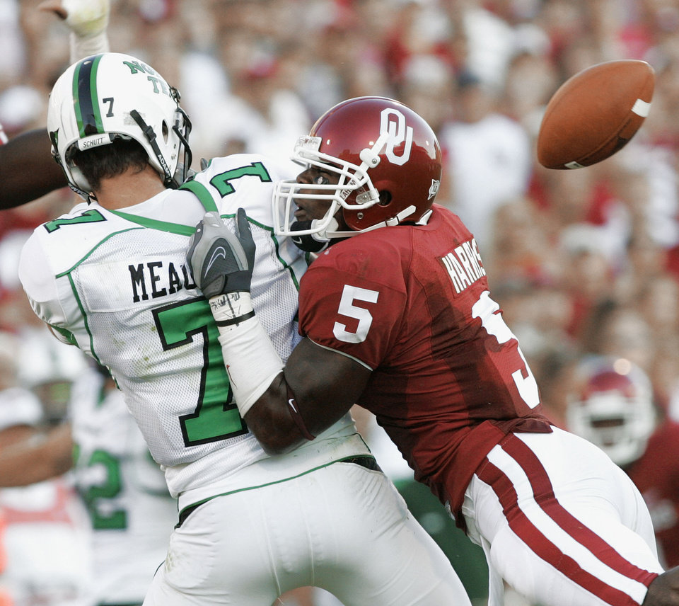 Photo - Oklahoma defensive back Nic Harris (5) causes North Texas quarterback Daniel Meager (7) to fumble in the second quarter of the first half during the University of Oklahoma Sooners (OU) college football game against the University of North Texas Mean Green (UNT) at the Gaylord Family - Oklahoma Memorial Stadium, on Saturday, Sept. 1, 2007, in Norman, Okla.
