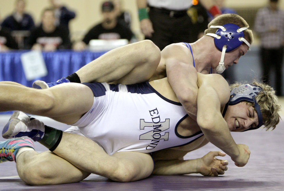 Photo - Sapulpa's Caleb Carter wrestles Edmond North's Andrew Dixon in the 195-pound match during the state wrestling championships at the State Fair Arena in Oklahoma City, Saturday, Feb. 25, 2012. Photo by Sarah Phipps, The Oklahoman